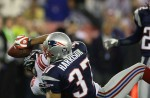 New York Giants David Tyree makes a timely catch on his helmet as he is defended by New England Patriots Rodney Harrison in Super Bowl XLII