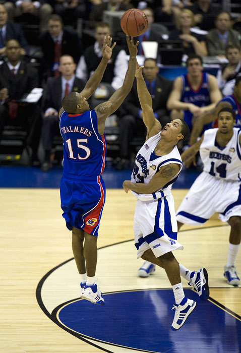 Kansas Jayhawks guard Mario Chalmers hits a three pointer at the end of regulation over Memphis Tigers guard Derrick Rose to tie the game and send the Championship into overtime