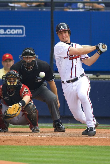 Atlanta Braves slugger Chipper Jones follows through on a hit at Turner Field against Arizona