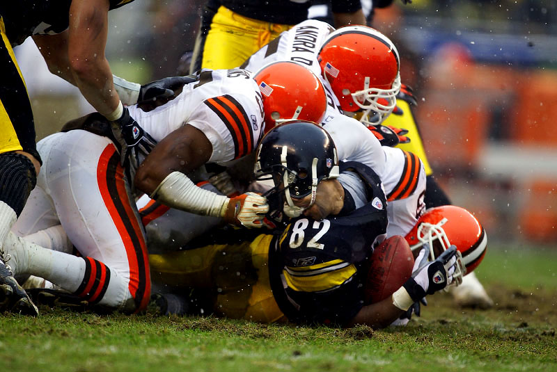 Pittsburgh Steelers kick returner Atwan Randle-El has his facemask pulled by Cleveland Browns Chris Atkins during the 2003 AFC Wild Card Playoff Game