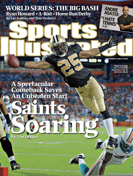 New Orleans Saints Reggie Bush leaps for a touchdown against the Miami Dolphins