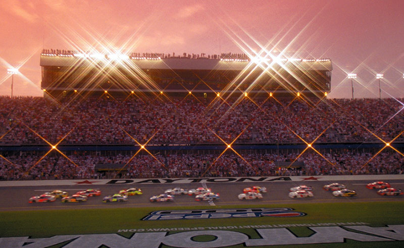 Cars hit the start of the Pepsi 400 at dusk at Daytona International Speedway