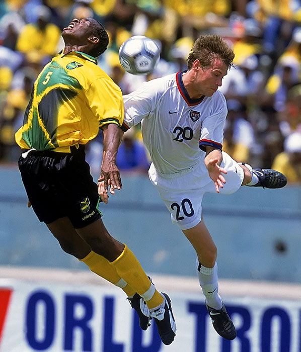 USA Brian McBride collides with Jamaican Ian Goodison going for a header during a World Cup Qualifying match in Kingston