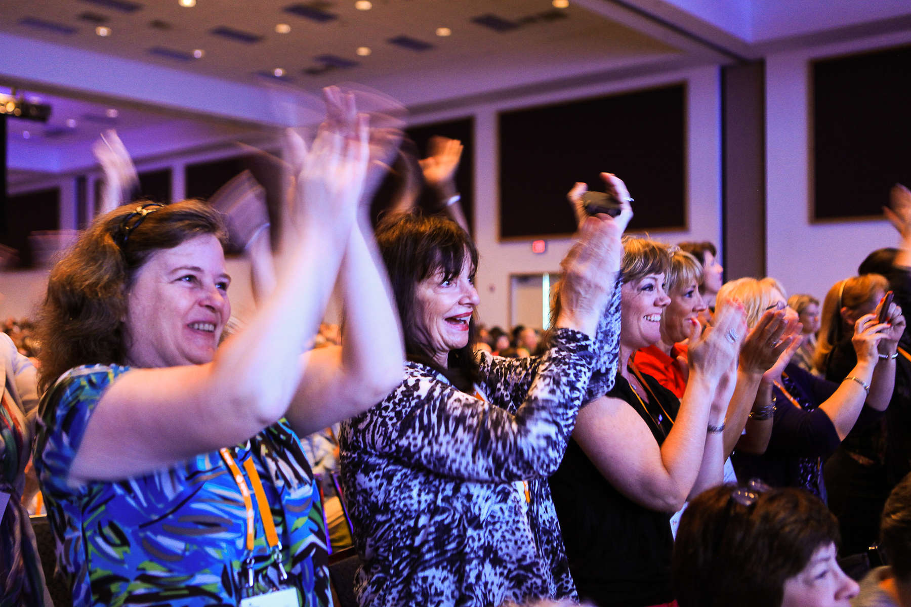 Attendees applaud APIC President Patti Grant during the opening session.