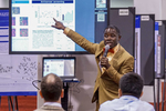 Bremansu Osa-Andrews presents his ePoster in the exhibit hall.