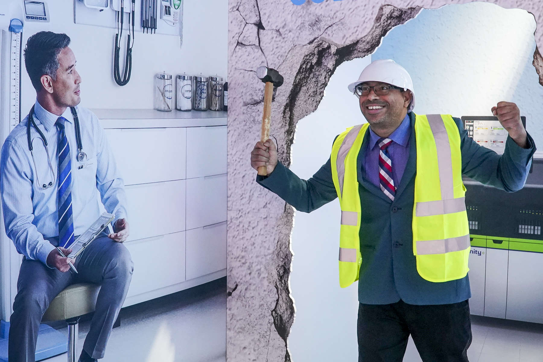 Rocky Pramanik gets his photo taken in construction gear at the Abbott booth in the exhibit hall.