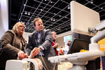 Monica Fuller shows Dr. Sven Kuestermann fusion and navigation technology with the Phillips PercuNav Epiq 7 Ultrasound system in the exhibit hall.