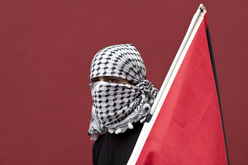 A Palestinian supporter takes part in a protest that drew people from both sides of the Israeli and Palestinian conflict in San Francisco, California.