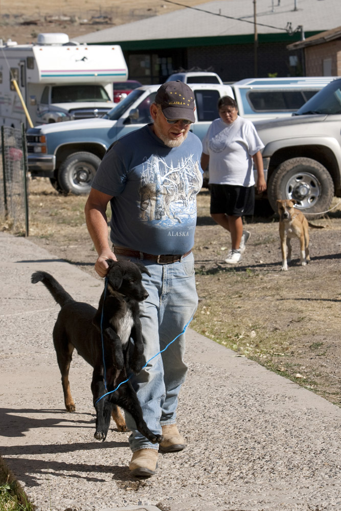 People arrive with their dogs during a clinic sponsored by the Humane Society of the United States August 16, 2009 in McDermitt Nevada.