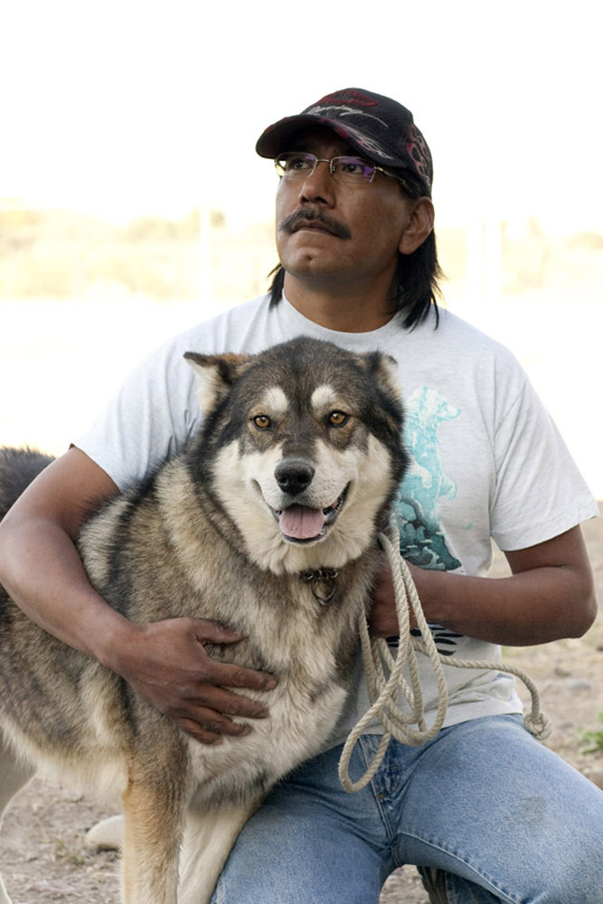 """Denala""  is held by his owner Vincent Dave during a clinic sponsored by the Humane Society of the United States August 17, 2009 in McDermitt Nevada."