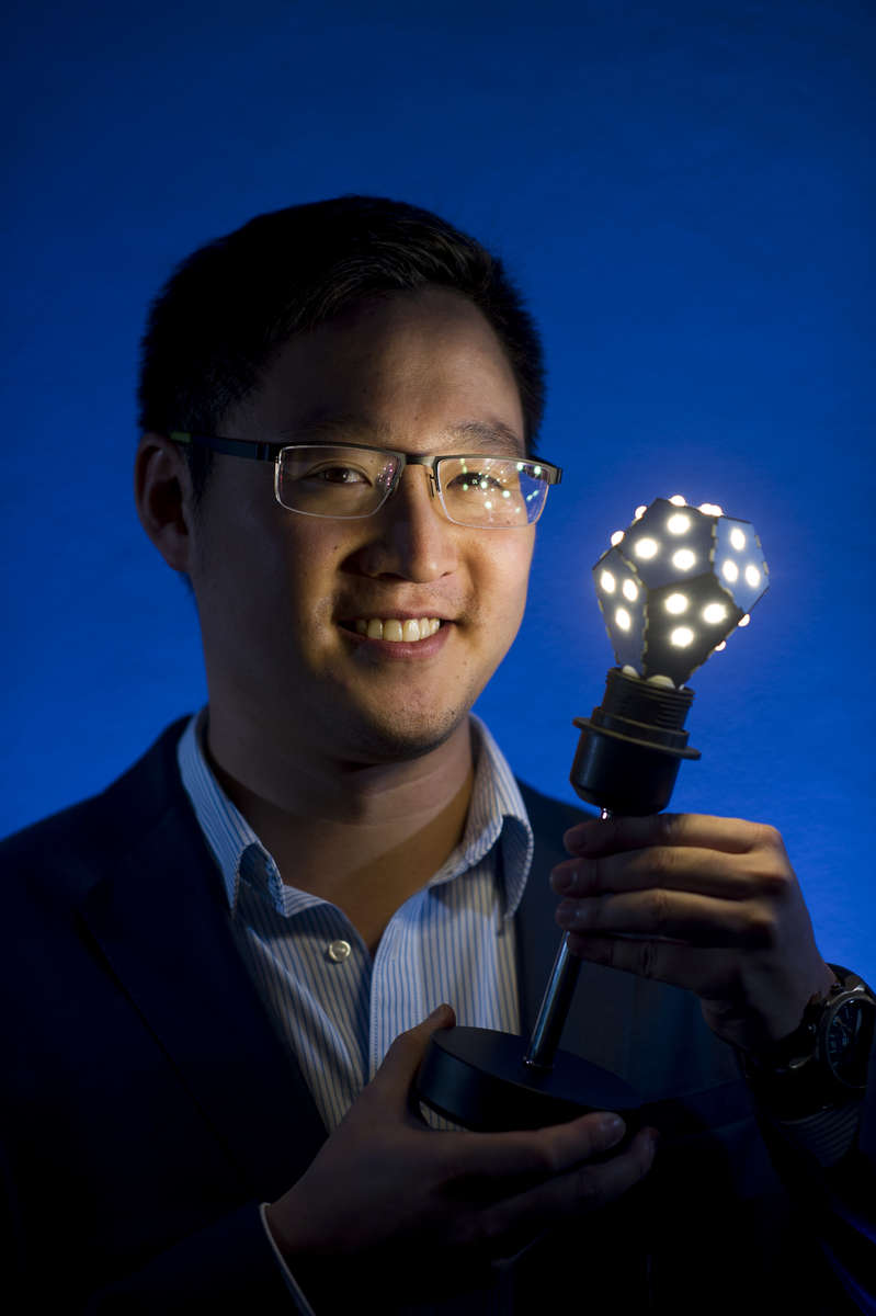 Gimmy Chu, co founder and chief executive officer at Nanoleaf Ltd., holds a Nanoleaf Ltd., lightbulb as he stands for a photograph after an interview in San Francisco, California, U.S., on Tuesday, Aug. 5, 2014. Nanoleaf Ltd. has developed the first LED light bulb that can change colors, save up to 88% of electricity and last 20 times longer compared to incandescent bulbs. Photograph by David Paul Morris