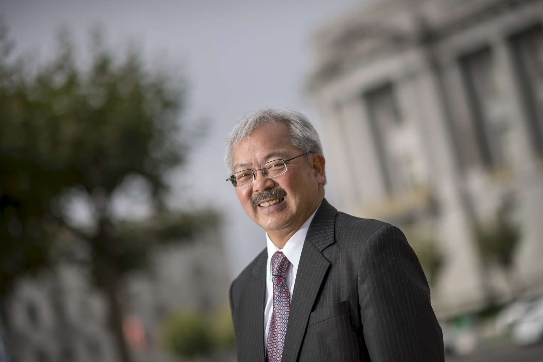 San Francisco Mayor Ed Lee stands for a photograph in front of the City Hall building in San Francisco, California, U.S., on Wednesday, Aug. 16, 2016. Photographer: David Paul Morris