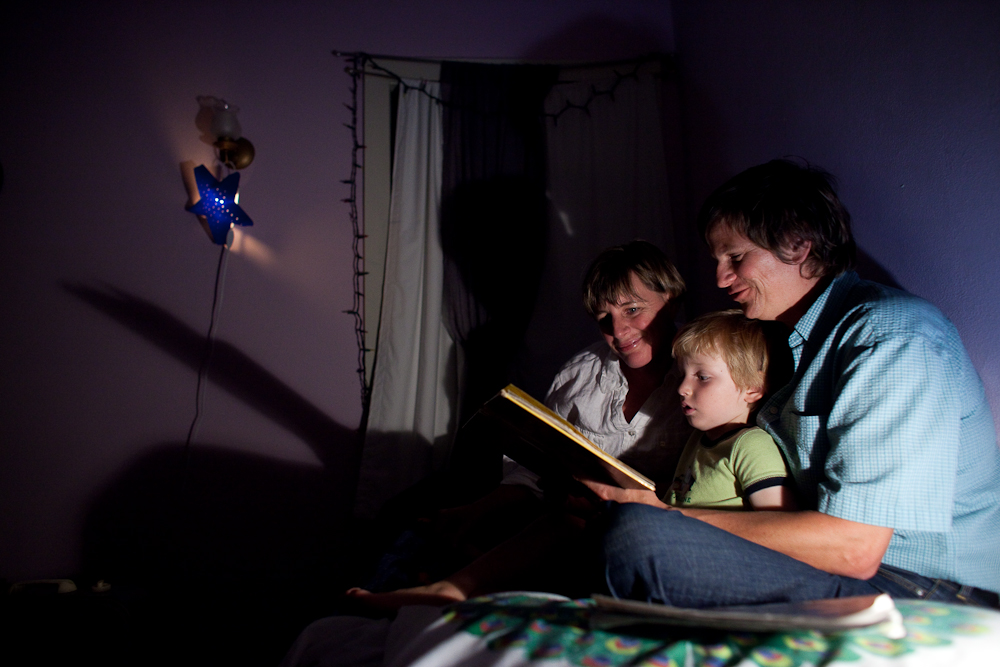 Lois Bukowski (R) and Katie Baer read to their son Wade Baer-Bukowski, 3 before he goes to bed at home in Oakland, California.