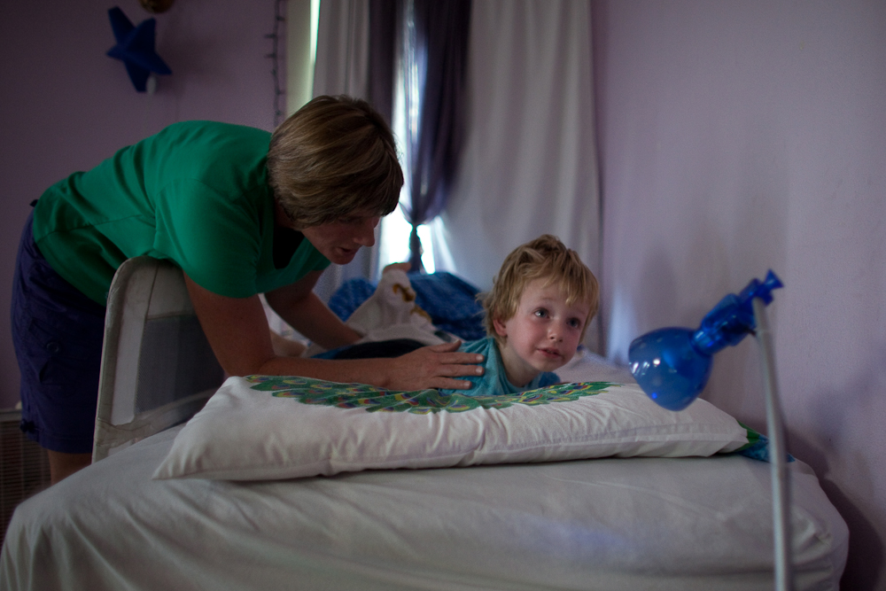 Katie Baer wakes up her son,Wade Baer-Bukowski, 3 after a nap at home in Oakland, California.