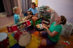 Lois Bukowski (C) and Katie Baer (R) play music with their son, Wade Baer-Bukowski, 3 at home in Oakland, California.