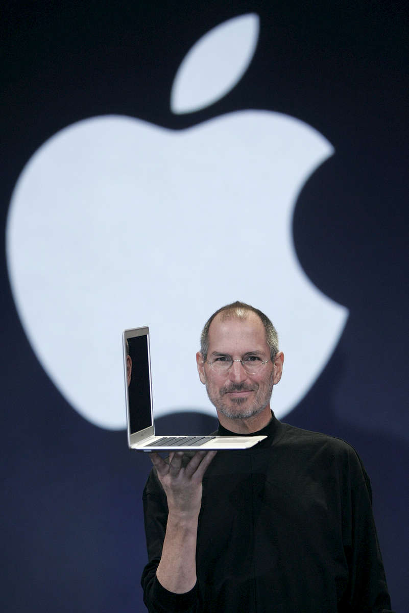 SAN FRANCISCO - JANUARY 15:  Apple CEO and co-founder Steve Jobs holds up the new Mac Book Air after he delivered the keynote speech to kick off the 2008 Macworld at the Moscone Center January 15, 2008 in San Francisco, California.  The new Mac Book Air will sell for $ 1799 and will be shipping in 2 weeks.  (Photo by David Paul Morris)