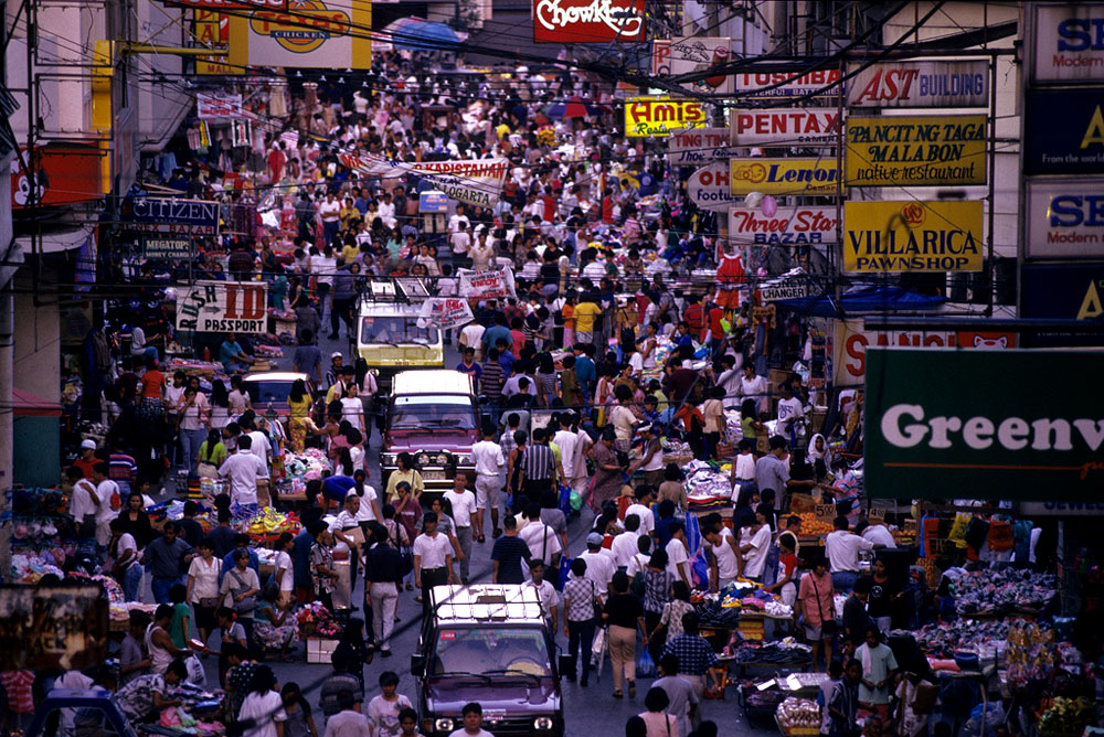 Masses of people fill the streets in Manila, Philippines.