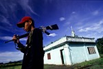 A young guard of the Abu Sayyaf watches over his mosque on the muslim island of Mindanao, Philippines.
