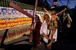 People take part in a Catholic march during Easter week in Manila, Philippines.