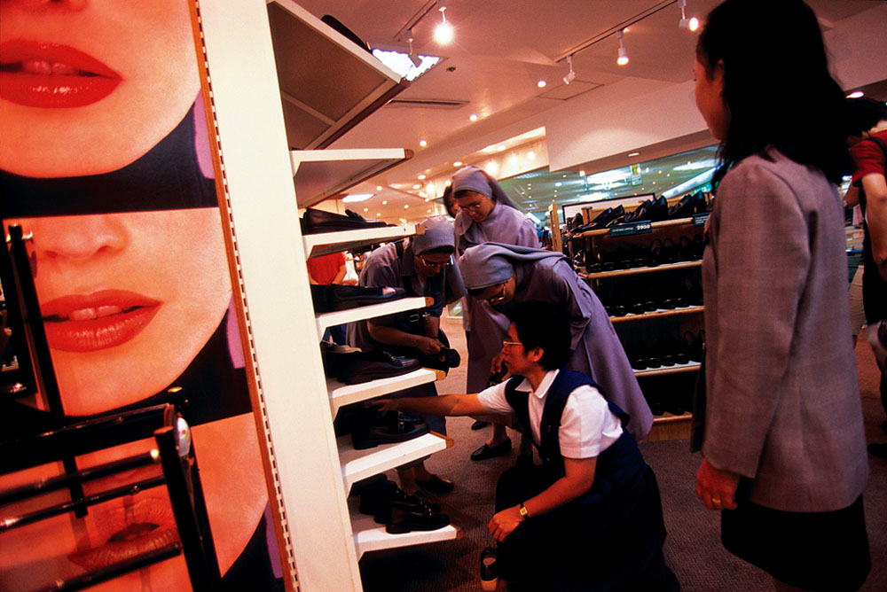 Catholic nuns look for shoes in a department store in Manila, Philippines.