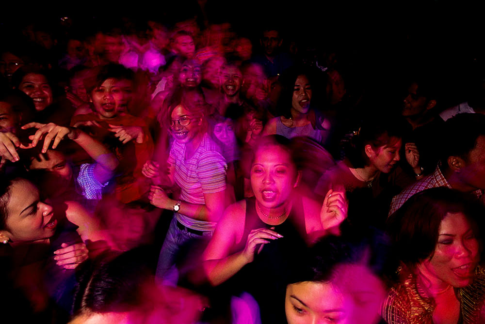 People have fun as they dance in a nightclub in Manila, Philippines.