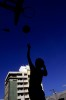 A young boy plays basketball in a park in Manila, Philippines.