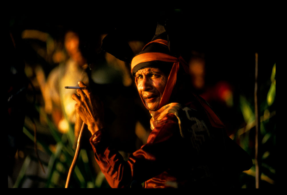 An elder man smokes a cigarette as he waits for the Pasola festival to begin on the island of Sumba, Indonesia.