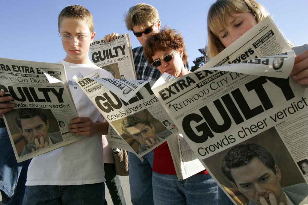 People read the headlines after Scott Peterson was found guilty of murdering his wife and unborn child.