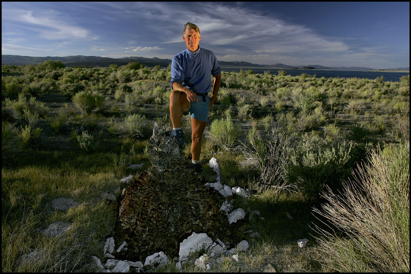Scott Stine, an internationally recognized authority on climate change whose scientific research and expert witness testimony helped preserve Mono Lake stands with a tree stump believed to be over 2,000 years old in the Mono Lake basin.