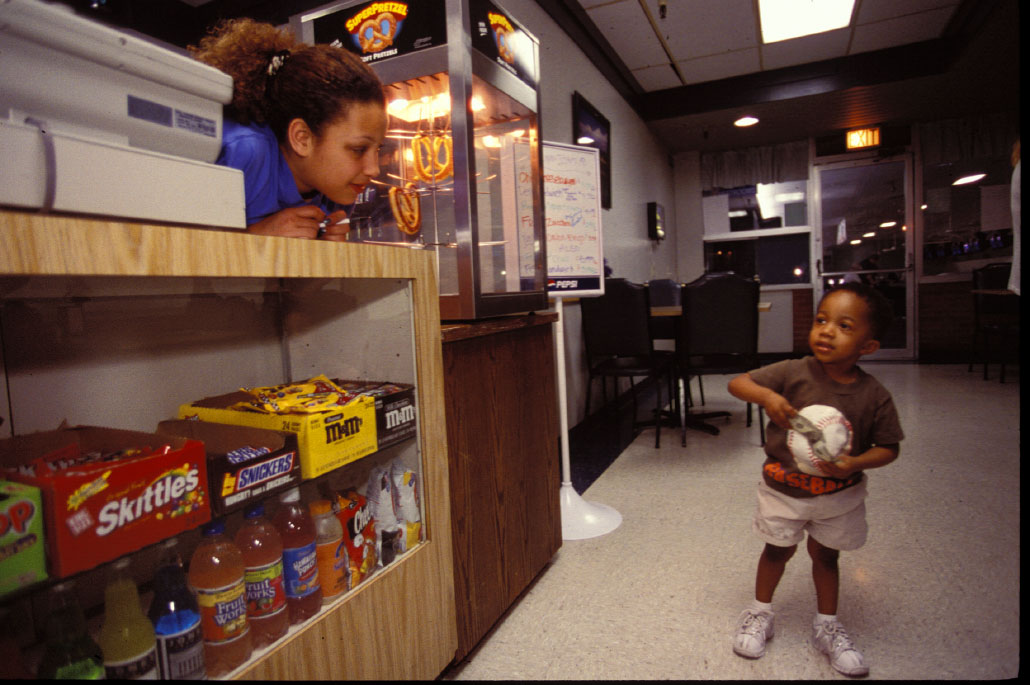 At work in the local bowling alley, Stephanie gets ready to serve 3 year old Thomas Smith.