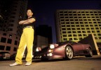 Mob boss Wan Kuok Koi stands in front of his Ferrari on the streets of Macau, China.