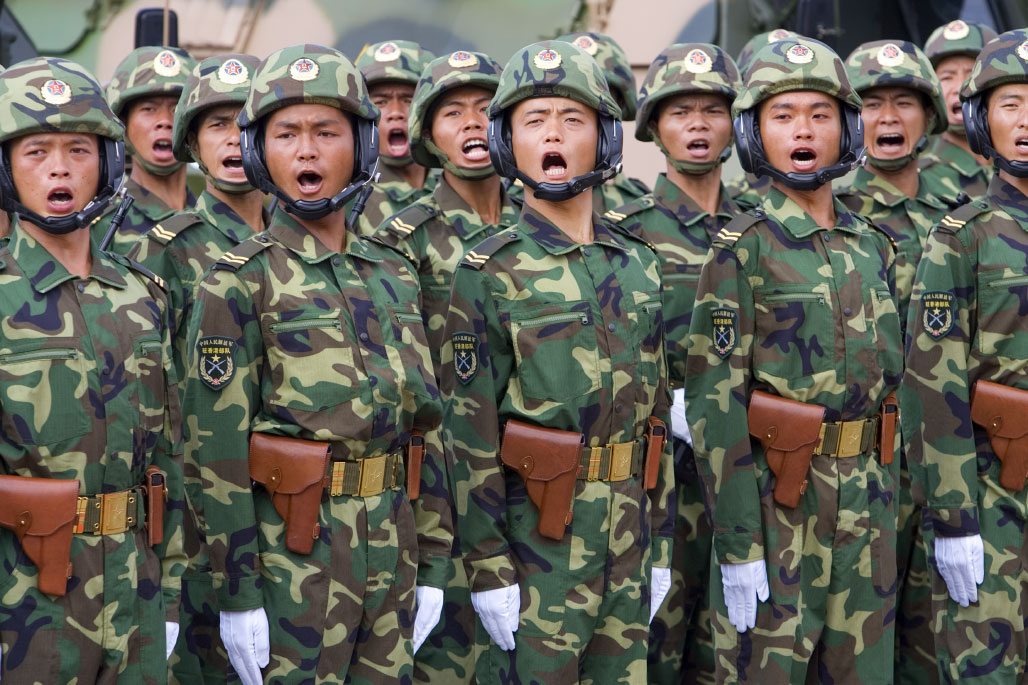 Members of the Peoples Liberation Army in Hong Kong yell out as Chinese President Hu Jintao inspects their garrison on June 30, 2007. Hu was in Hong Kong to celebrate the 10th anniversary of the hand over.