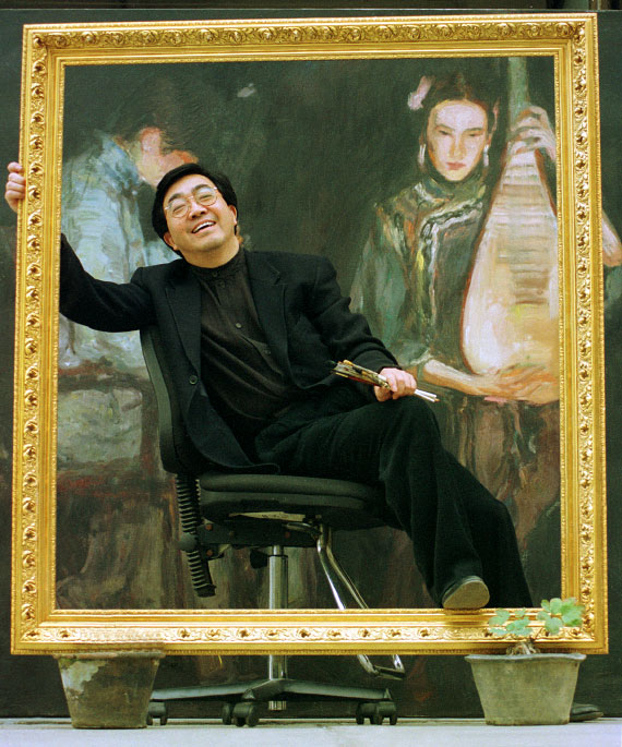 Chinese artist Chan Yi Fei poses at his home in Shanghai, China