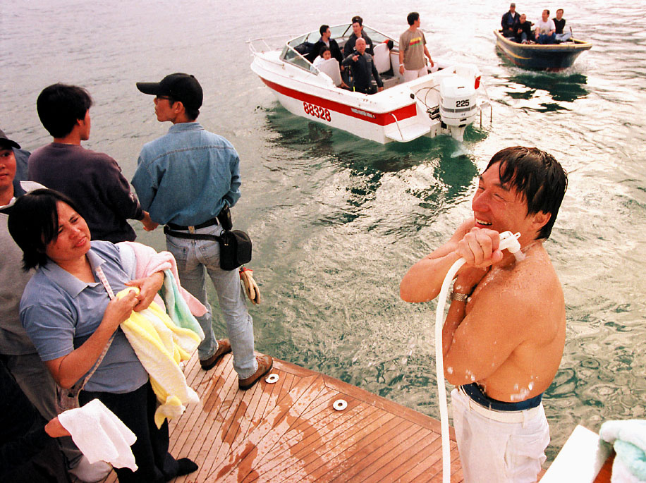 Jackie rinses off salt water after filming a scene on location in Sai Kung, Hong Kong
