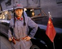 A young girl poses in a PLA uniform in Beijing, China.