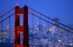 The Golden Gate Bridge stands at the entrance to the San Francisco bay with San Francisco in the background.