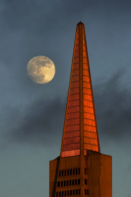 The full moon rises over the TransAmerica building in San Francisco.