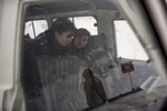 Female deminers - Vartanoush Asaturova and Vartiter Shaboyan - wait out a blizzard in their vehicle.  They are working on demining an anti-personnel mine field in the Lachin province.