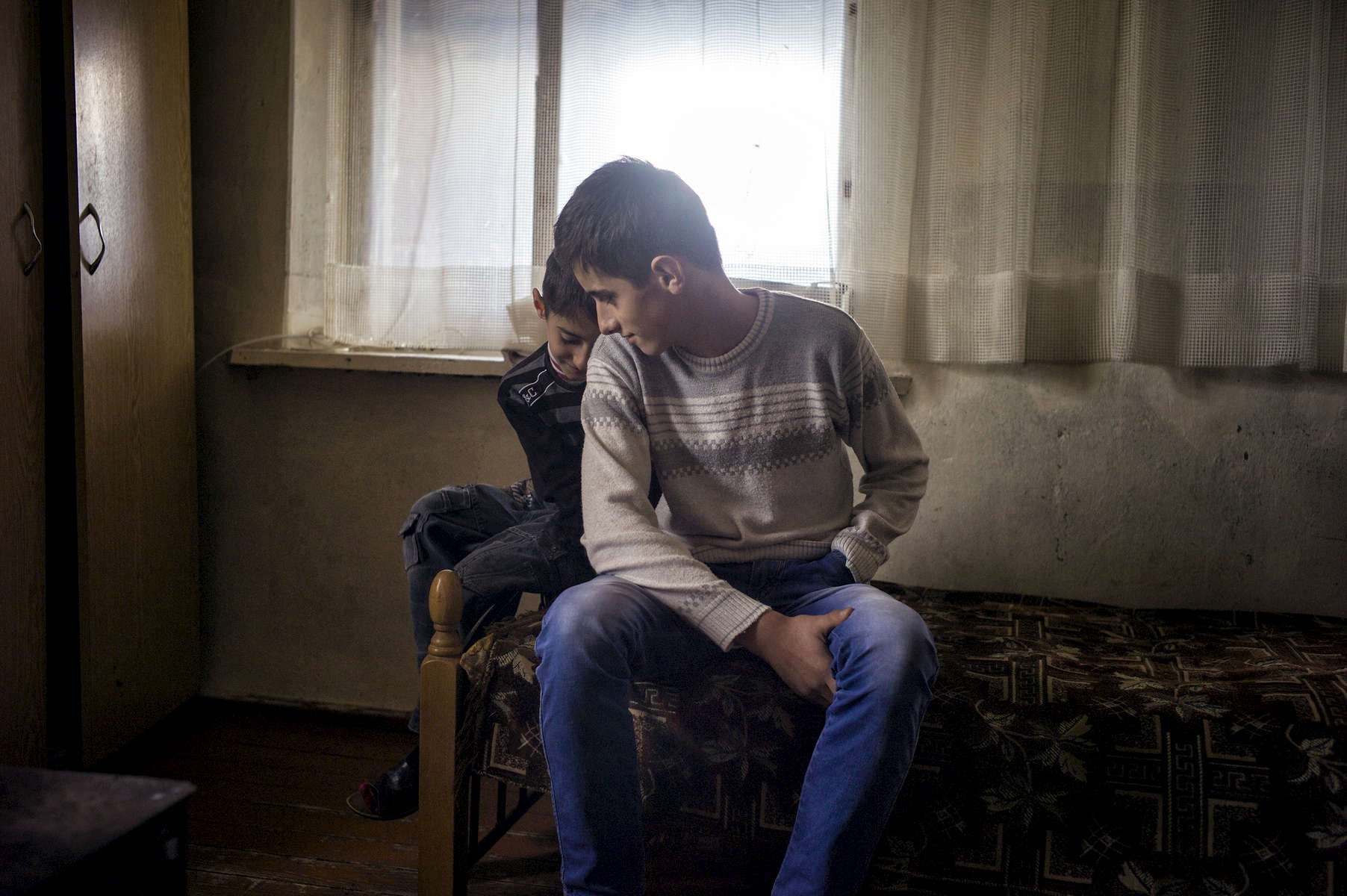 Karen Mirzoyan and his younger brother Tigran. Karen lost his hand while playing with unexploded ordnance that he had found in his backyard.