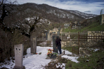 A man kisses his brother's gravestone in the cemetery beside Gandzasar monastery. The area around the monastery, and especially around the cemetery, was cleared by HALO
