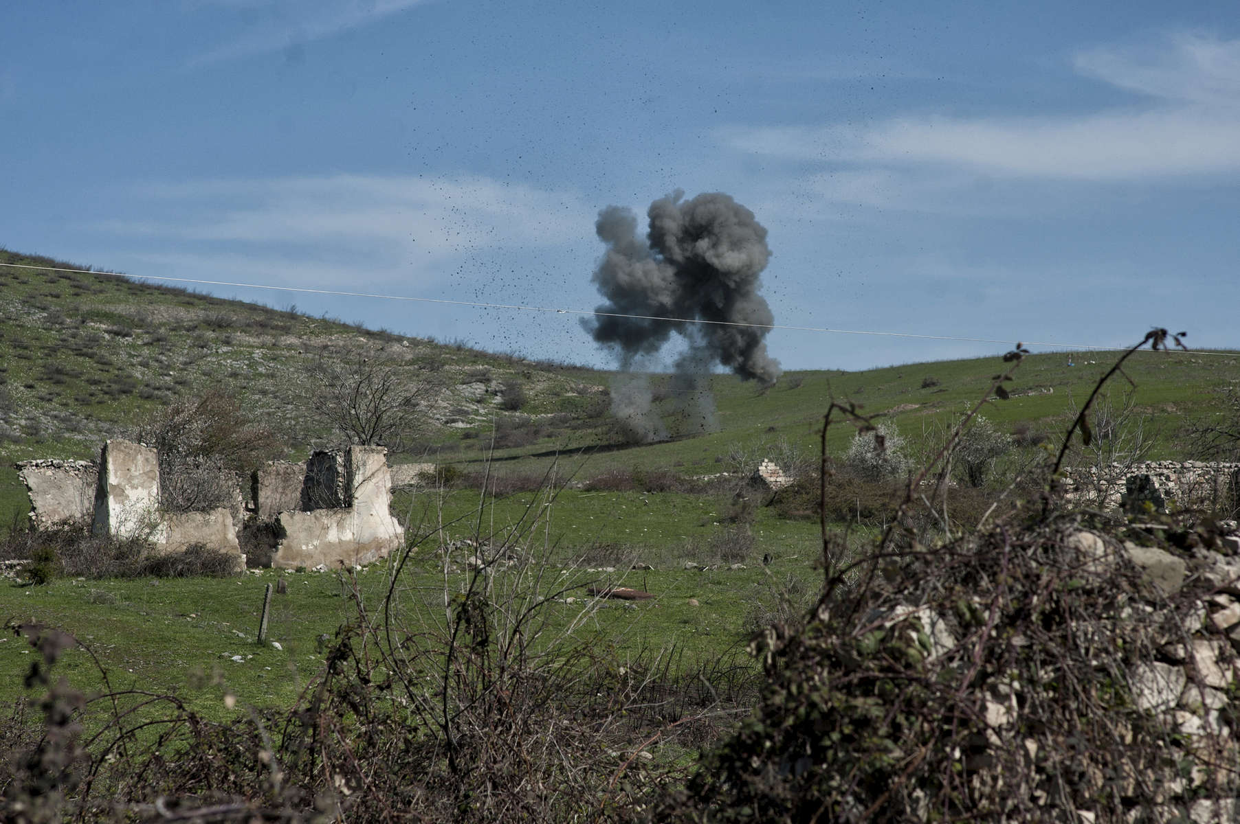 HALO deminers dispose of an anti-tank mine in the Govshatly minefield.