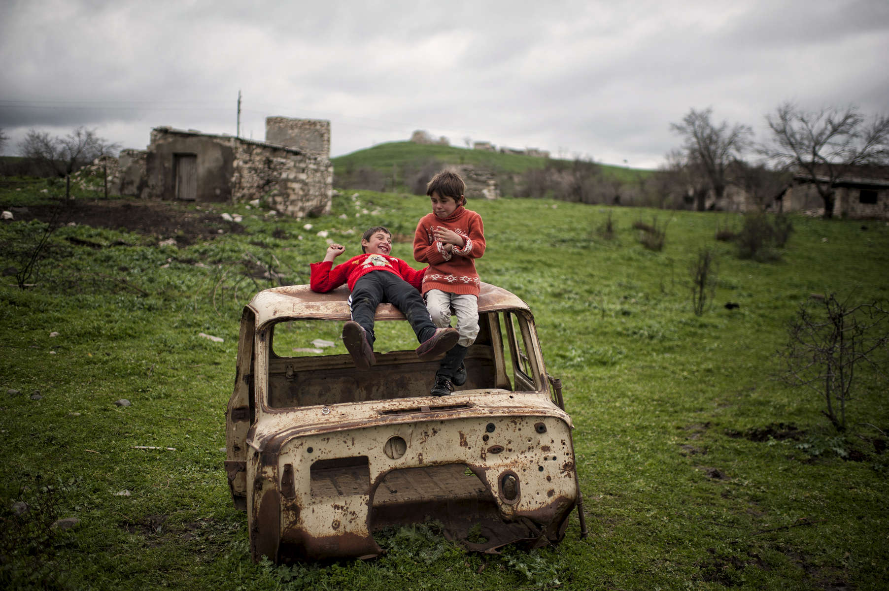 The Piryan family - father Roma, mother Nune, and children 13 year-old Merujan, 8 year-old Gita, and baby Anna live right on the edge of an anti-tank and anti-personnel minefield.  The parents are constantly worried that their children will wander into the field while playing.