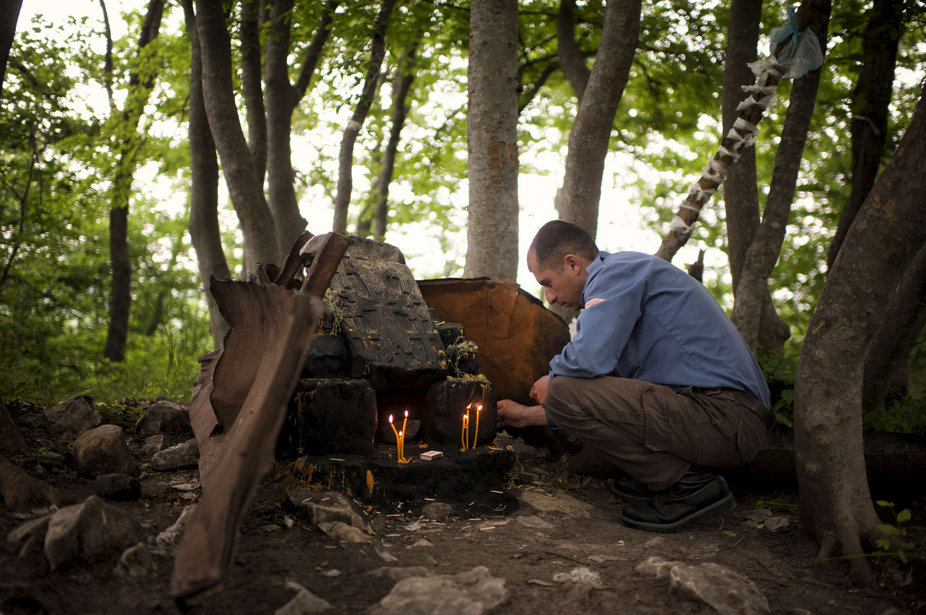 HALO supervisor Melord Aslanian lights candles at a small shrine near Govshatly village in the Hadrut region.