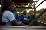 May 3, 2018: KANENGUERERE, ANGOLA - HALO deminer Valentina Sikato sits in the back of the truck as HALO staff drop off equipment at the minefields on their first day back at work in Kanenguerere.