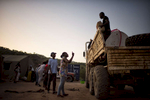 May 2, 2018: KANENGUERERE, ANGOLA - HALO deminer Esperança Ngando takes charge of unloading the truck on their first night back in Kanenguerere demining camp.