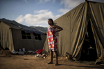 May 6, 2018: KANENGUERERE, ANGOLA -HALO deminer Rosalina Loth stands in front of her tent on Sunday morning. The HALO team has Sundays off, so the day is spent going to church, relaxing, and getting caught up on work. These deminers are working under extremely difficult circumstances in Kanenguerere.  Not only is extremely hot - with snakes and scorpions common - but much of the mined area is on the side of an extremely steep hill, making every step dangerous. The area was mined during the civil war by government forces to protect the nearby railway line that can be seen in the background, as well as various troop positions. It is currently used by roughly 170 people including village residents and nomadic herders - many of whom are young children - who pass through uncleared land every day.