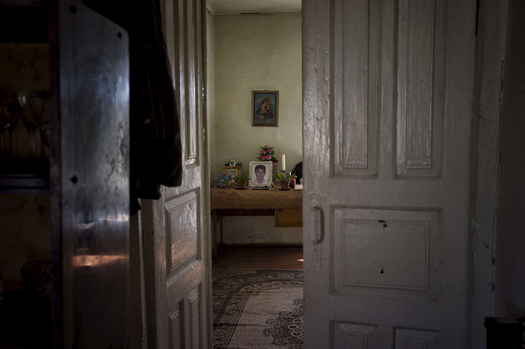 The mother of 14 year-old Gor Davidi Vanyan (I am a monster and have forgotten her name.  Is it Anoush?), who was killed while playing with a SA 12.7 mm, sits in her home in Haterk village.