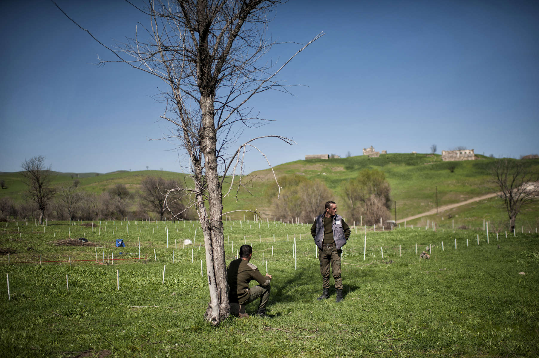21 year-old deminer Aramayis Agopov chats with his brother Pavel Agopov, 27 in the Norashen anti-tank minefield.  Both brothers work as deminers for HALO trust, and Pavel is one of the best deminers HALO employs.NOTE: AGES SHOULD BE DOUBLE CHECKED - I HAVE HEARD 2 DIFFERENT AGES FOR BOTH BROTHERS. ALSO WE HAVE LONG INTERVIEWS WITH BOTH.