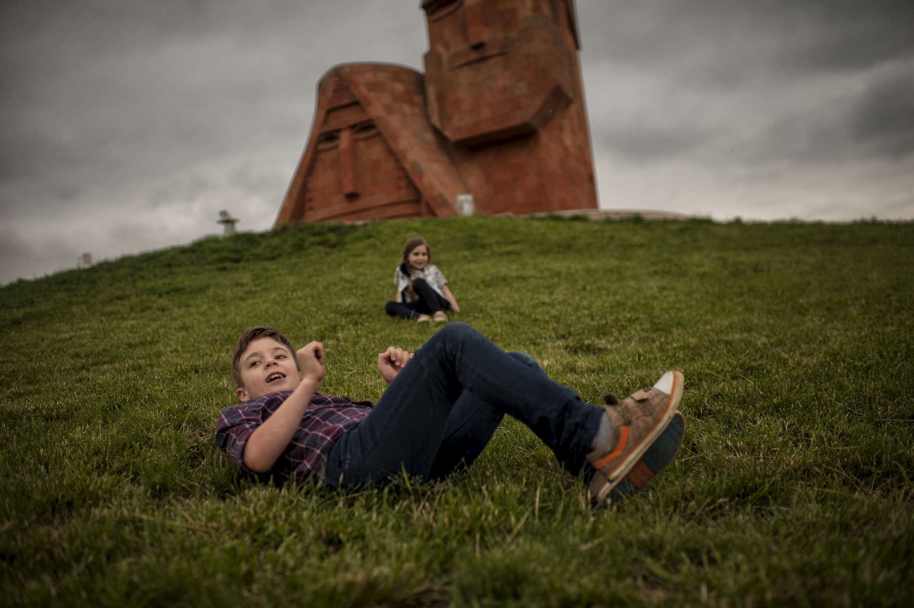 HALO Program Manager Yuri Shahramanyan spends a Sunday evening visiting the famous Papik Tatik {quote}We Are Our Mountains{quote} statue with his family on the outskirts of Stepanakert.