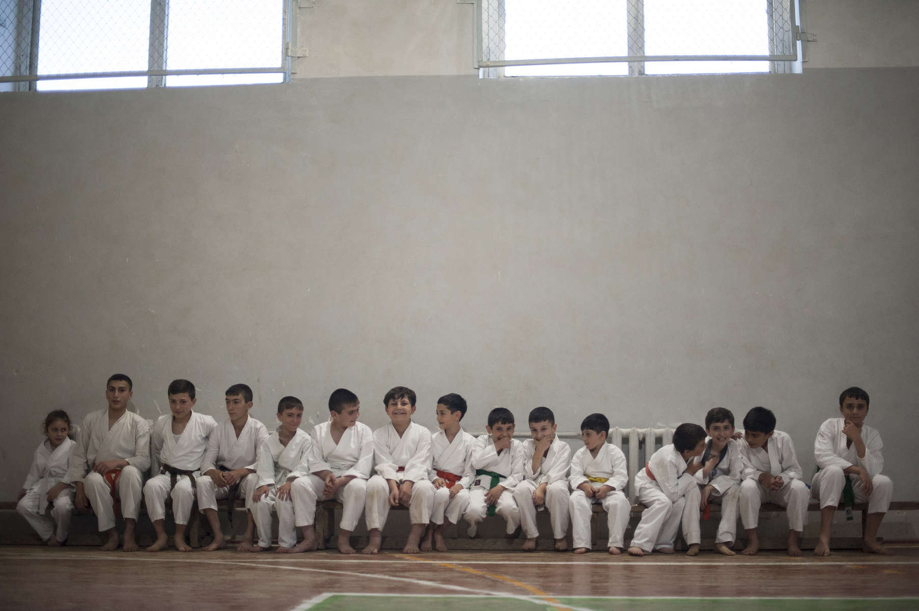 HALO supervisor Narek Arakelian teaches a karate class after work at School # 8 in Stepanakert.  His two daughters also participate in the classes and his eldest is a two-time champion.